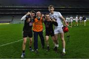 22 November 2020; Kildare players, from left, Mark Doyle, Seán Bean and James Burke with selector Declan O'Toole celebrate after the Christy Ring Cup Final match between Down and Kildare at Croke Park in Dublin. Photo by Piaras Ó Mídheach/Sportsfile