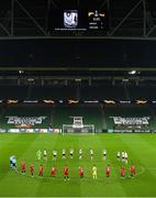 26 November 2020; Players from both teams observe a minutes silence for the late Diego Armando Maradona prior to the UEFA Europa League Group B match between Dundalk and SK Rapid Wien at Aviva Stadium in Dublin. Photo by Eóin Noonan/Sportsfile