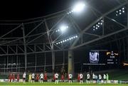 26 November 2020; Players of both side's stand for a minutes silence for the late Argentinian International Diego Maradona ahead of the UEFA Europa League Group B match between Dundalk and SK Rapid Wien at Aviva Stadium in Dublin. Photo by Ben McShane/Sportsfile
