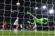 26 November 2020; Ercan Kara of SK Rapid Wien scores his side's third goal despite the efforts of Gary Rogers of Dundalk during the UEFA Europa League Group B match between Dundalk and SK Rapid Wien at Aviva Stadium in Dublin. Photo by Eóin Noonan/Sportsfile