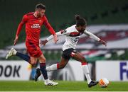 26 November 2020; Nathan Oduwa of Dundalk and Mateo Barac of SK Rapid Wien during the UEFA Europa League Group B match between Dundalk and SK Rapid Wien at Aviva Stadium in Dublin. Photo by Ben McShane/Sportsfile