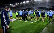21 November 2020; Dublin media manager Seamus McCormack, left, as the captain prepares to lay a wreath after the Leinster GAA Football Senior Championship Final match between Dublin and Meath at Croke Park in Dublin. Photo by Ray McManus/Sportsfile