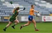 28 November 2020; Chloe Moloney of Clare in action against Orlagh Lally of Meath during the TG4 All-Ireland Intermediate Ladies Football Championship Semi-Final match between Clare and Meath at MW Hire O'Moore Park in Portlaoise, Laois. Photo by Brendan Moran/Sportsfile