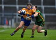 28 November 2020; Niamh O'Dea of Clare is tackled by Emma Troy of Meath during the TG4 All-Ireland Intermediate Ladies Football Championship Semi-Final match between Clare and Meath at MW Hire O'Moore Park in Portlaoise, Laois. Photo by Brendan Moran/Sportsfile