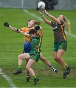 28 November 2020; Monica McGuirk of Meath saves under pressure from team-mate Emma Troy and Niamh O'Dea of Clare during the TG4 All-Ireland Intermediate Ladies Football Championship Semi-Final match between Clare and Meath at MW Hire O'Moore Park in Portlaoise, Laois. Photo by Brendan Moran/Sportsfile