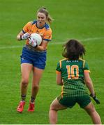 28 November 2020; Chloe Moloney of Clare in action against Emma Duggan of Meath during the TG4 All-Ireland Intermediate Ladies Football Championship Semi-Final match between Clare and Meath at MW Hire O'Moore Park in Portlaoise, Laois. Photo by Brendan Moran/Sportsfile