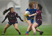 29 November 2020; Honor Ennis of Roscommon in action against Lucy McCartan, right, and Ciara Blundell of Westmeath during the TG4 All-Ireland Intermediate Ladies Football Championship Semi-Final match between Roscommon and Westmeath at Glennon Brothers Pearse Park in Longford. Photo by Sam Barnes/Sportsfile