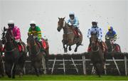 29 November 2020; Twobeelucky, centre, with Hugh Morgan up, jumps the second during the Bar One Racing Extra Places Handicap Hurdle on day two of the Fairyhouse Winter Festival at Fairyhouse Racecourse in Ratoath, Meath. Photo by Seb Daly/Sportsfile
