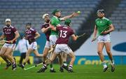 29 November 2020; William O'Donoghue of Limerick in action against Daithí Burke and Brian Concannon, 13, of Galway during the GAA Hurling All-Ireland Senior Championship Semi-Final match between Limerick and Galway at Croke Park in Dublin. Photo by Piaras Ó Mídheach/Sportsfile