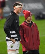 30 November 2020; Munster head coach Johann van Graan, right, speaks to Thomas Ahern of Munster ahead of his debut in the Guinness PRO14 match between Munster and Zebre at Thomond Park in Limerick. Photo by Ramsey Cardy/Sportsfile