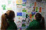 30 November 2020; Amber Barrett, left, and Harriet Scott admire school kids artwork following a Republic of Ireland training session at Tallaght Stadium in Dublin. Photo by Stephen McCarthy/Sportsfile