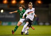 1 December 2020; Pia-Sophie Wolter of Germany in action against Katie McCabe of Republic of Ireland during the UEFA Women's EURO 2022 Qualifier match between Republic of Ireland and Germany at Tallaght Stadium in Dublin. Photo by Eóin Noonan/Sportsfile