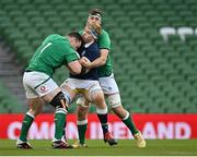 5 December 2020; Jonny Gray of Scotland is tackled by Cian Healy, left, and Caelan Doris of Ireland during the Autumn Nations Cup match between Ireland and Scotland at the Aviva Stadium in Dublin. Photo by Seb Daly/Sportsfile