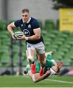 5 December 2020; Duhan van der Merwe of Scotland is tackled by Hugo Keenan of Ireland during the Autumn Nations Cup match between Ireland and Scotland at the Aviva Stadium in Dublin. Photo by Ramsey Cardy/Sportsfile