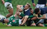 5 December 2020; Chris Harris of Scotland is tackled by Jonathan Sexton, left, and CJ Stander of Ireland during the Autumn Nations Cup match between Ireland and Scotland at the Aviva Stadium in Dublin. Photo by Ramsey Cardy/Sportsfile
