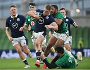 5 December 2020; Duhan van der Merwe of Scotland is tackled by Conor Murray and Bundee Aki of Ireland during the Autumn Nations Cup match between Ireland and Scotland at the Aviva Stadium in Dublin. Photo by Ramsey Cardy/Sportsfile