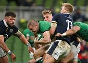 5 December 2020; Jacob Stockdale of Ireland is tackled by  Chris Harris of Scotland during the Autumn Nations Cup match between Ireland and Scotland at the Aviva Stadium in Dublin. Photo by Ramsey Cardy/Sportsfile
