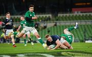 5 December 2020; Duhan van der Merwe of Scotland dives over to score his side's first try, despite the efforts of Ireland's Keith Earls, during the Autumn Nations Cup match between Ireland and Scotland at the Aviva Stadium in Dublin. Photo by Seb Daly/Sportsfile