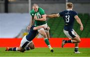 5 December 2020; Jacob Stockdale of Ireland is tackled by Sam Hidalgo-Clyne of Scotland during the Autumn Nations Cup match between Ireland and Scotland at the Aviva Stadium in Dublin. Photo by Ramsey Cardy/Sportsfile