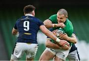 5 December 2020; Jacob Stockdale of Ireland is tackled by Scott Cummings, hidden, and Ali Price of Scotland during the Autumn Nations Cup match between Ireland and Scotland at the Aviva Stadium in Dublin. Photo by Seb Daly/Sportsfile