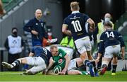 5 December 2020; Keith Earls of Ireland scores his side's first try, despite the efforts of Scotland's Ali Price, during the Autumn Nations Cup match between Ireland and Scotland at the Aviva Stadium in Dublin. Photo by Seb Daly/Sportsfile