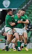 5 December 2020; Keith Earls of Ireland is congratulated by team-mates Andrew Porter, left, and Robbie Henshaw after scoring his side's first try during the Autumn Nations Cup match between Ireland and Scotland at the Aviva Stadium in Dublin. Photo by Seb Daly/Sportsfile