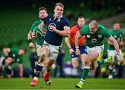 5 December 2020; Duhan van der Merwe of Scotland evades the tackle of Ireland's Jacob Stockdale on his way to scoring his side's first try during the Autumn Nations Cup match between Ireland and Scotland at the Aviva Stadium in Dublin. Photo by Seb Daly/Sportsfile