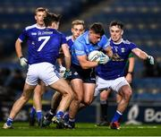 5 December 2020; Brian Howard of Dublin is tackled by Luke Fortune, left, and Pádraig Faulkner of Cavan on his way to scoing a point during the GAA Football All-Ireland Senior Championship Semi-Final match between Cavan and Dublin at Croke Park in Dublin. Photo by Ray McManus/Sportsfile