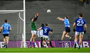 5 December 2020; Robert McDaid of Dublin shoots to score his side's first goal past Raymond Galligan of Cavan during the GAA Football All-Ireland Senior Championship Semi-Final match between Cavan and Dublin at Croke Park in Dublin. Photo by Eóin Noonan/Sportsfile