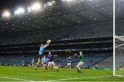 5 December 2020; Robert McDaid of Dublin shoots to score his side's first goal past Cavan goalkeeper Raymond Galligan during the GAA Football All-Ireland Senior Championship Semi-Final match between Cavan and Dublin at Croke Park in Dublin. Photo by Stephen McCarthy/Sportsfile