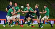 5 December 2020; Jacob Stockdale of Ireland, supported by team-mates Eric O'Sullivan, left, and Peter O'Mahony, is tackled by Matt Fagerson and Jaco van der Walt of Scotland during the Autumn Nations Cup match between Ireland and Scotland at the Aviva Stadium in Dublin. Photo by Ramsey Cardy/Sportsfile