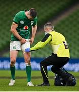 5 December 2020; Jonathan Sexton of Ireland  is attended to by team doctor Dr Ciaran Cosgrave during the Autumn Nations Cup match between Ireland and Scotland at the Aviva Stadium in Dublin. Photo by Ramsey Cardy/Sportsfile