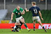 5 December 2020; Jacob Stockdale of Ireland is tackled by Huw Jones of Scotland during the Autumn Nations Cup match between Ireland and Scotland at the Aviva Stadium in Dublin. Photo by Ramsey Cardy/Sportsfile