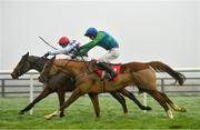 6 December 2020; Power Of Pause, right, with David Mullins up, races alongside eventual second place Crosshill, with Robbie Power up, on their way to winning the Irish Racing Industry Fundraiser For Children's Health Foundation Crumlin In Memory Of Pat Smullen Rated Novice Hurdle at Punchestown Racecourse in Kildare. Photo by Seb Daly/Sportsfile