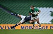 5 December 2020; Bundee Aki of Ireland is tackled by Jaco van der Walt of Scotland during the Autumn Nations Cup match between Ireland and Scotland at the Aviva Stadium in Dublin. Photo by Seb Daly/Sportsfile