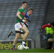 6 December 2020; Brian Fox of Tipperary shoots past Patrick Durcan of Mayo to score a goal in the 11th minute of the GAA Football All-Ireland Senior Championship Semi-Final match between Mayo and Tipperary at Croke Park in Dublin. Photo by Ray McManus/Sportsfile