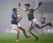 6 December 2020; Colm O'Shaughnessy of Tipperary in action against Cillian O'Connor of Mayo during the GAA Football All-Ireland Senior Championship Semi-Final match between Mayo and Tipperary at Croke Park in Dublin. Photo by Harry Murphy/Sportsfile