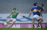 6 December 2020; Cillian O'Connor of Mayo shoots to score his side's second goal past Tipperary goalkeeper Evan Comerford during the GAA Football All-Ireland Senior Championship Semi-Final match between Mayo and Tipperary at Croke Park in Dublin. Photo by Ramsey Cardy/Sportsfile