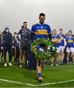 6 December 2020; Tipperary captain Conor Sweeney carries a wreath to place at the Bloody Sunday memorial on Hill 16 after the GAA Football All-Ireland Senior Championship Semi-Final match between Mayo and Tipperary at Croke Park in Dublin. Photo by Brendan Moran/Sportsfile