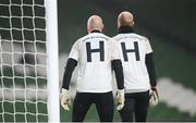 6 December 2020; Gary Rogers, left, and Aaron McCarey of Dundalk warm-up wearing a t-shirt in tribute to the late Dundalk groundsman and videographer Harry Taaffe prior to the Extra.ie FAI Cup Final match between Shamrock Rovers and Dundalk at the Aviva Stadium in Dublin. Photo by Stephen McCarthy/Sportsfile