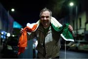 7 December 2020; Dundalk supporter 'Maxi' Mark Kavanagh, with an Irish tri-colour given to him by the late Dundalk videographer Harry Taaffe, following the Dundalk squads return to Dundalk after defeating Shamrock Rovers in the Extra.ie FAI Cup Final match in the Aviva Stadium in Dublin earlier. The players and staff stayed on the bus due to COVID-19 restrictions. Photo by Ben McShane/Sportsfile