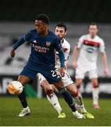 10 December 2020; Joe Willock of Arsenal in action against Jordan Flores of Dundalk during the UEFA Europa League Group B match between Dundalk and Arsenal at the Aviva Stadium in Dublin. Photo by Ben McShane/Sportsfile