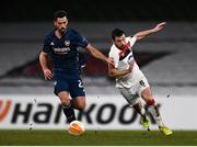 10 December 2020; Pablo Marí of Arsenal in action against Jordan Flores of Dundalk/ during the UEFA Europa League Group B match between Dundalk and Arsenal at the Aviva Stadium in Dublin. Photo by Ben McShane/Sportsfile