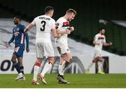 10 December 2020; Sean Hoare of Dundalk celebrates with team-mate Brian Gartland after scoring his side's second goal during the UEFA Europa League Group B match between Dundalk and Arsenal at the Aviva Stadium in Dublin. Photo by Ben McShane/Sportsfile