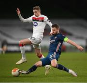 10 December 2020; Shkodran Mustafi of Arsenal in action against Daniel Kelly of Dundalk during the UEFA Europa League Group B match between Dundalk and Arsenal at the Aviva Stadium in Dublin. Photo by Stephen McCarthy/Sportsfile
