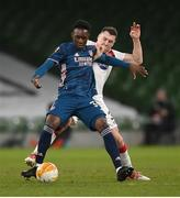10 December 2020; Folarin Balogun of Arsenal in action against Brian Gartland of Dundalk during the UEFA Europa League Group B match between Dundalk and Arsenal at the Aviva Stadium in Dublin. Photo by Stephen McCarthy/Sportsfile
