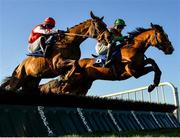 12 December 2020; Peckham Springs, left, with Adam Short up, jumps the second alongside Ilmig, with Paddy Kennedy up, on their way to winning the Thanks To All Our Sponsors In 2020 3-Y-O Maiden Hurdle at Fairyhouse Racecourse in Ratoath, Meath. Photo by Seb Daly/Sportsfile