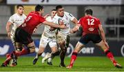 11 December 2020; Rynhardt Elstadt of Toulouse is tackled by Sam Carter, left, and Stuart McCloskey of Ulster during the Heineken Champions Cup Pool B Round 1 match between Ulster and Toulouse at Kingspan Stadium in Belfast. Photo by Ramsey Cardy/Sportsfile