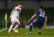 10 December 2020; Sean Gannon of Dundalk and Pablo Marí of Arsenal during the UEFA Europa League Group B match between Dundalk and Arsenal at the Aviva Stadium in Dublin. Photo by Ben McShane/Sportsfile