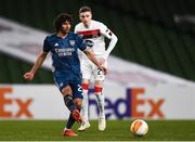 10 December 2020; Mohamed Elneny of Arsenal and Daniel Kelly of Dundalk during the UEFA Europa League Group B match between Dundalk and Arsenal at the Aviva Stadium in Dublin. Photo by Ben McShane/Sportsfile